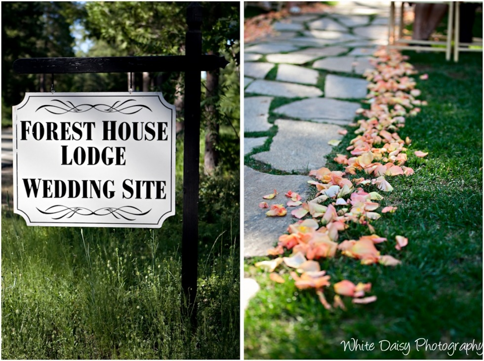forest house lodge wedding site signage and aisle