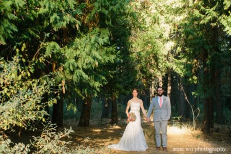 wedding bride and groom casually walking in the forest